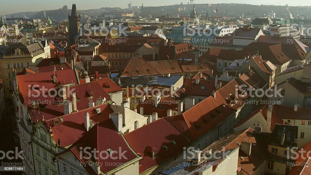 Tiled roofs of old town in Prague on a sunny stock photo