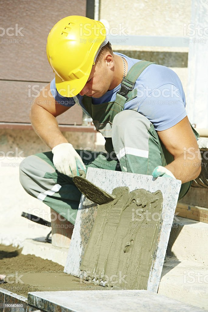 tiler at granite stairs way construction works royalty-free stock photo
