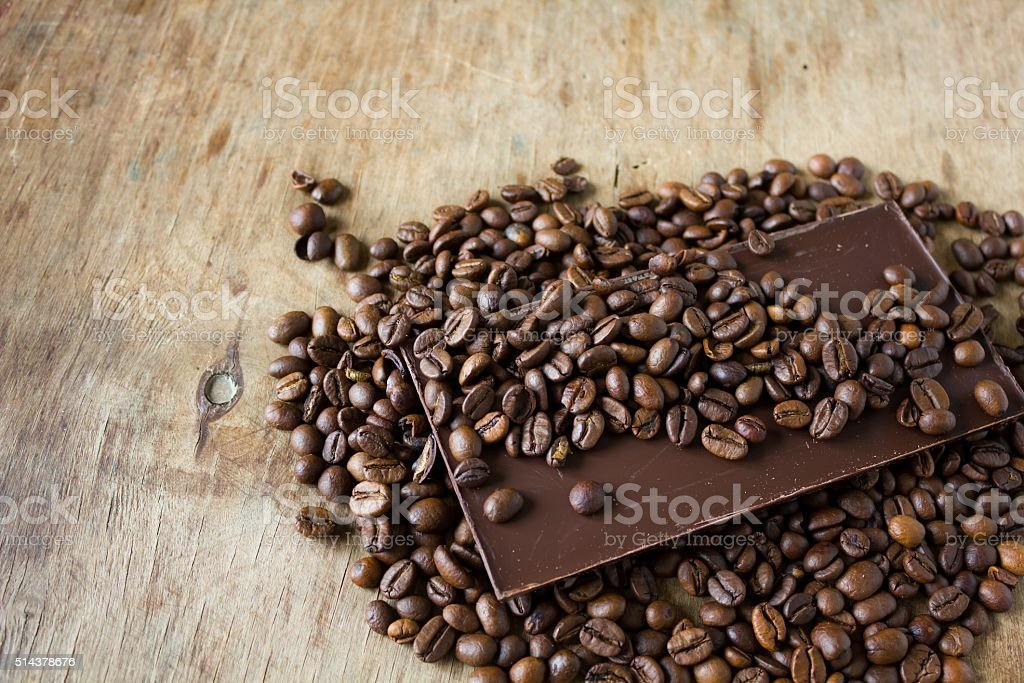 Tiles of dark chocolate and coffee beans stock photo