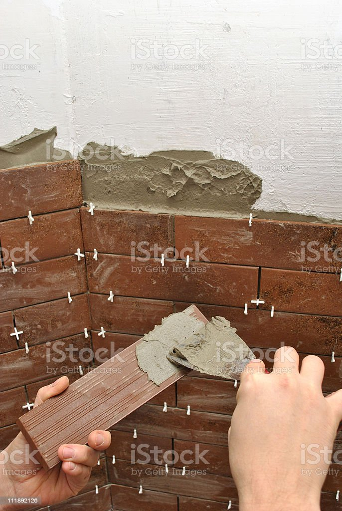 Tiling A Wall royalty-free stock photo
