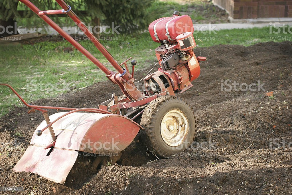 Tilling the Garden- Breaking New Ground stock photo