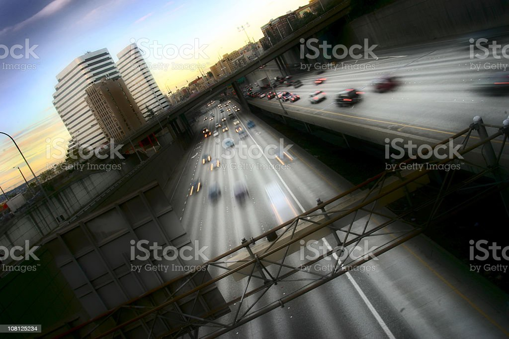 Tilt and Motion Blur of Traffic on Highway at Sunset royalty-free stock photo