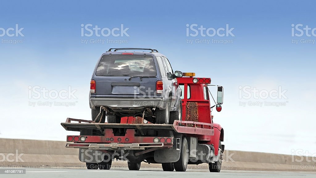Tilt Bed Tow Truck stock photo