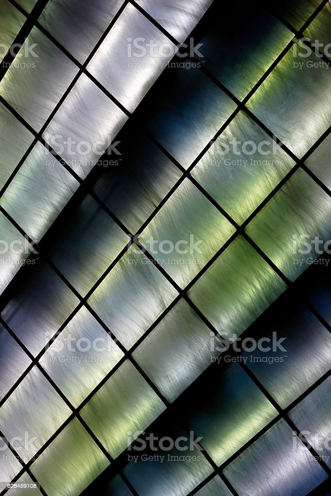 Tilt close-up photo of stained-glass window / wall stock photo