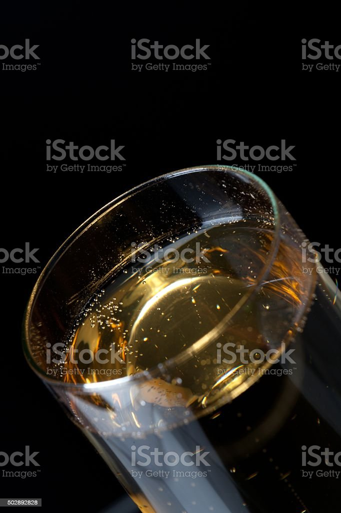 tilt glass filled with champagne stock photo