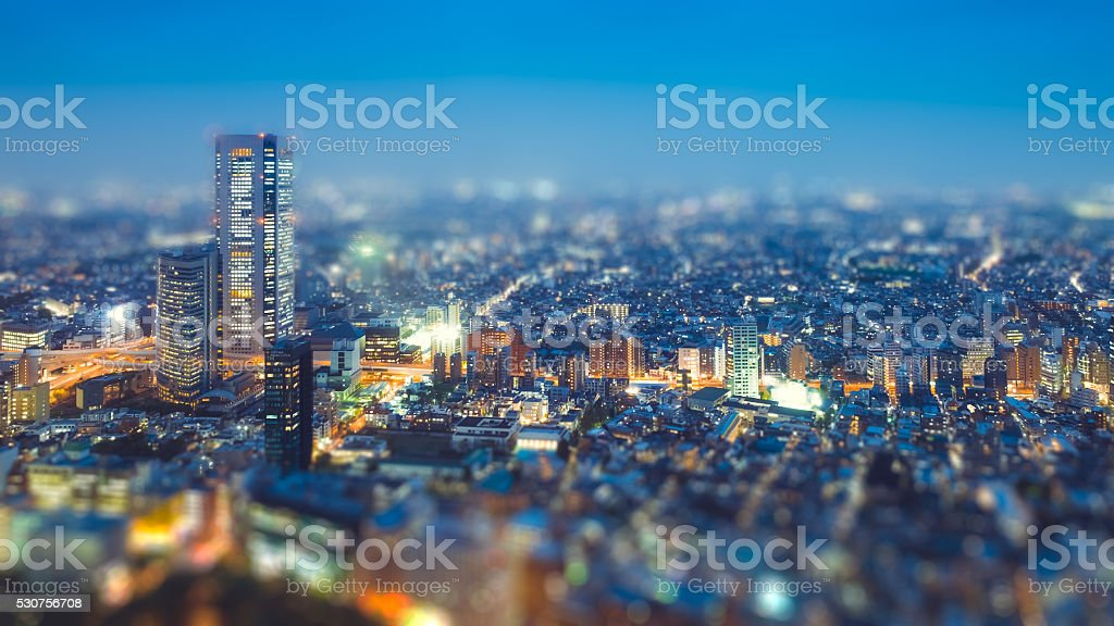 Tilt shift Photo High-rising buildings lighting up in tokyo stock photo
