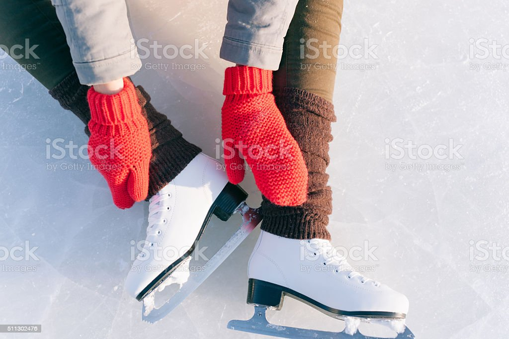 Tilted blue version, ice skates with reflection stock photo