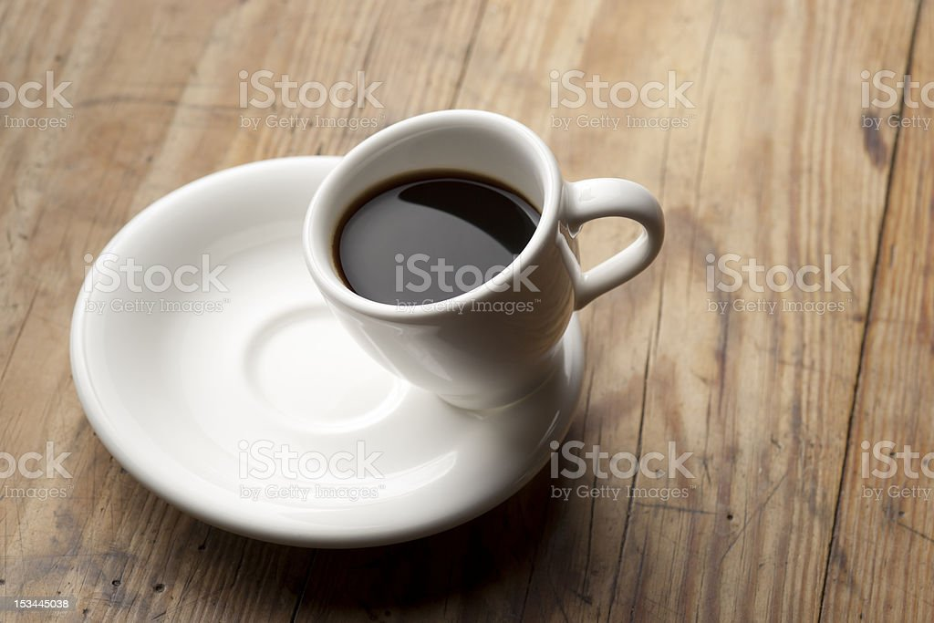 Tilted coffee cup. royalty-free stock photo
