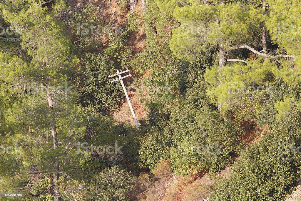 tilted electricity supply pole in Troodos cypriate mountains  Cyprus stock photo
