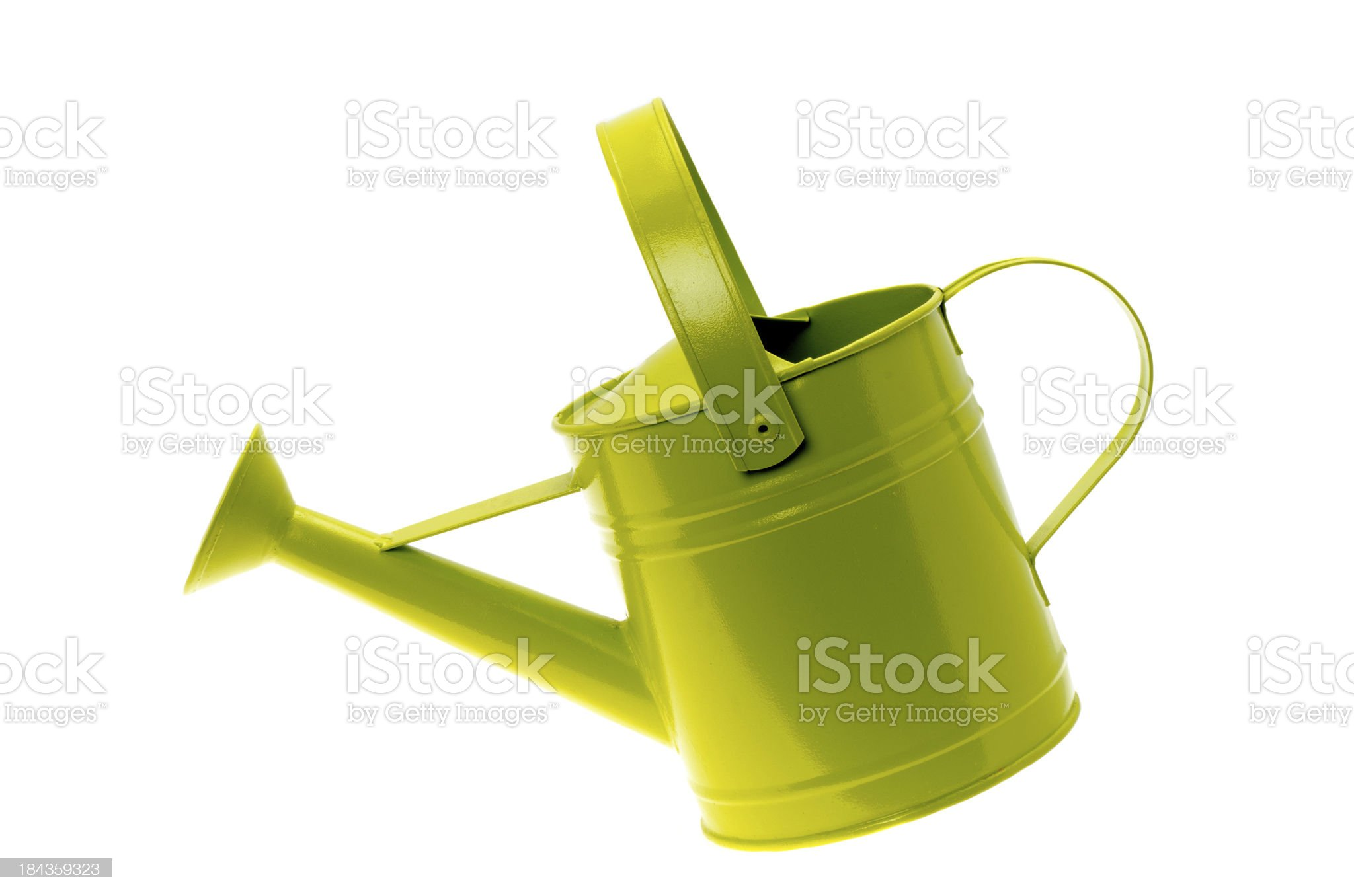 Tilted green coloured metal watering can royalty-free stock photo