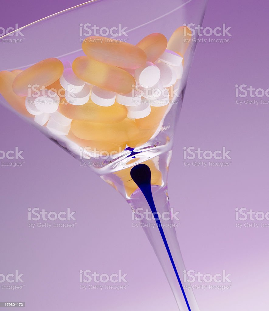 Tilted Martini Glass With Pills royalty-free stock photo