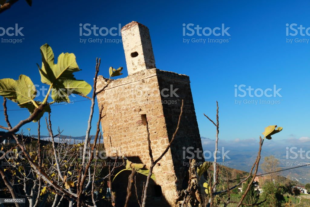Tilted mosque minaret stock photo