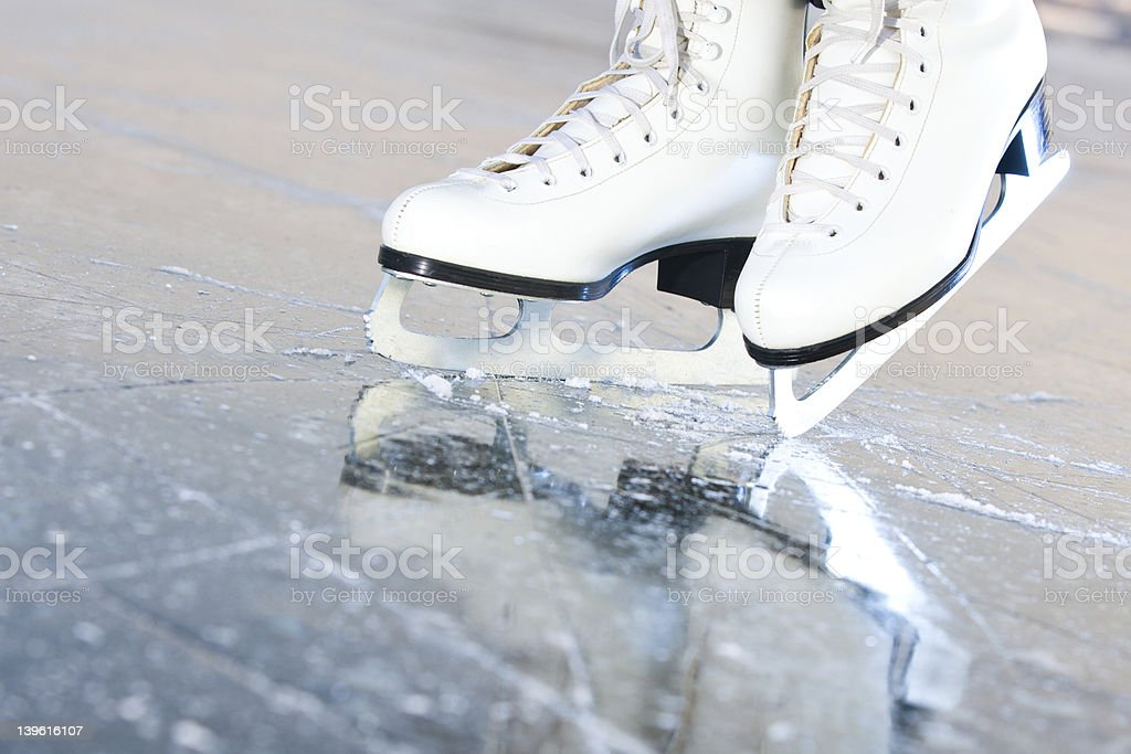 Tilted natural version, ice skates with reflection stock photo