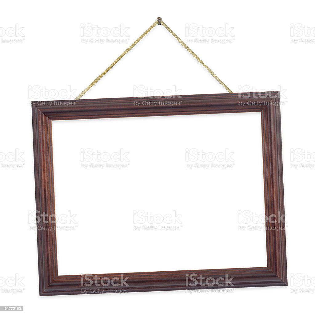 Tilted wooden frame hanging on a string royalty-free stock photo