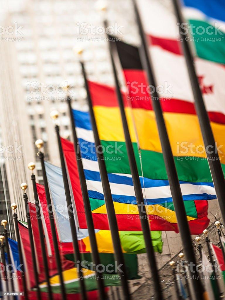 Tilt-shift lens international flags in Rockefeller Plaza, NYC stock photo