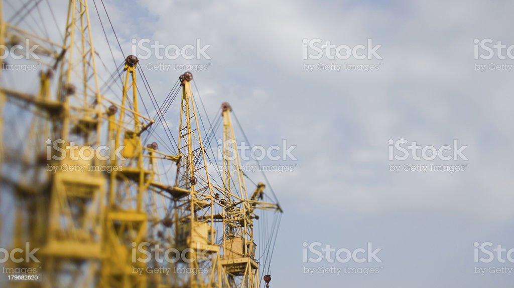 Tilt-shift photo of building cranes royalty-free stock photo