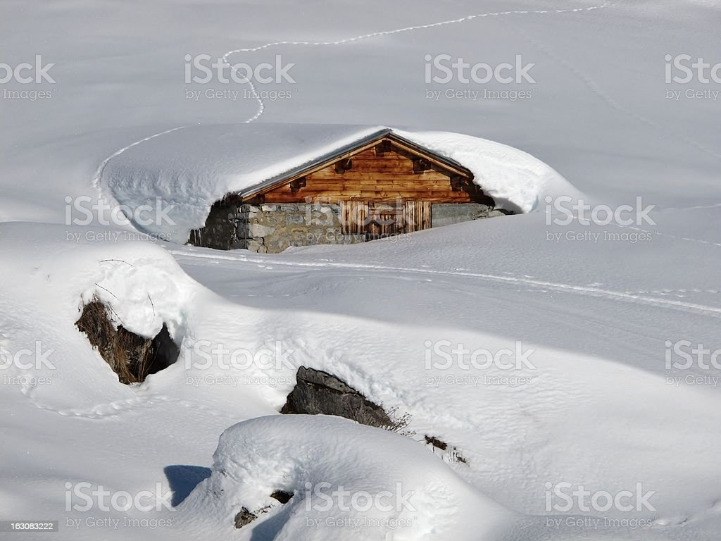 Timber hut covered by snow stock photo
