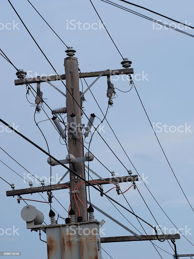 Timber power pole and transformer stock photo