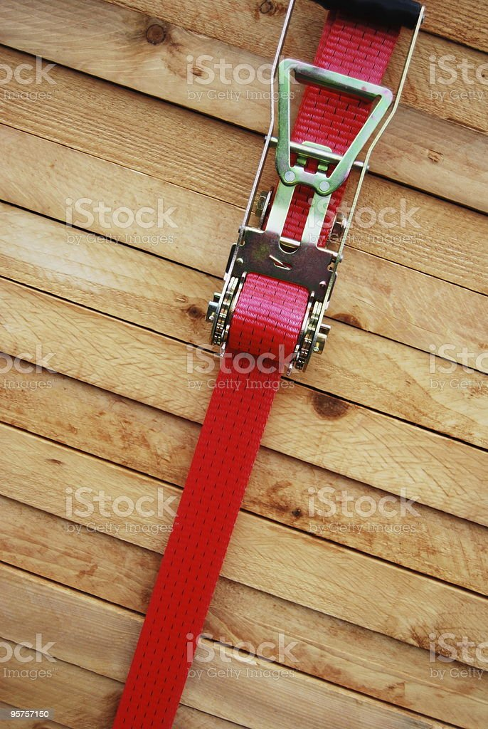 Timber with lashing strap stock photo