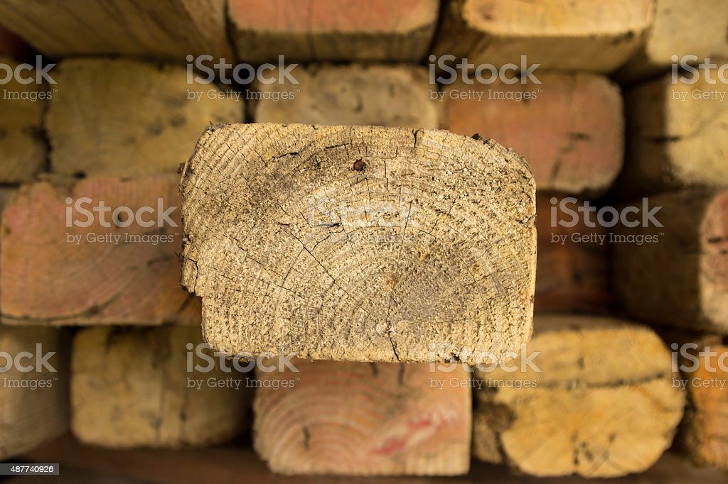 Timber with one plank poking out stock photo