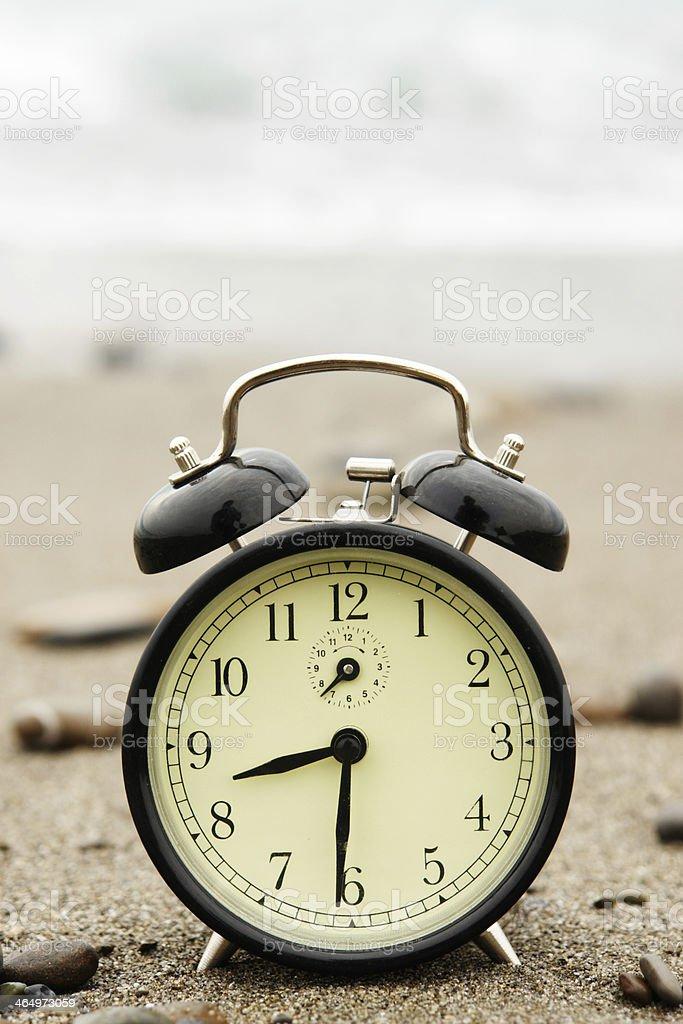Time Alarm clock at beach royalty-free stock photo