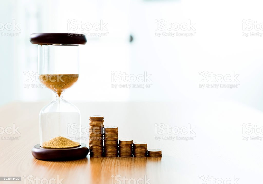 Time and stack of coins stock photo