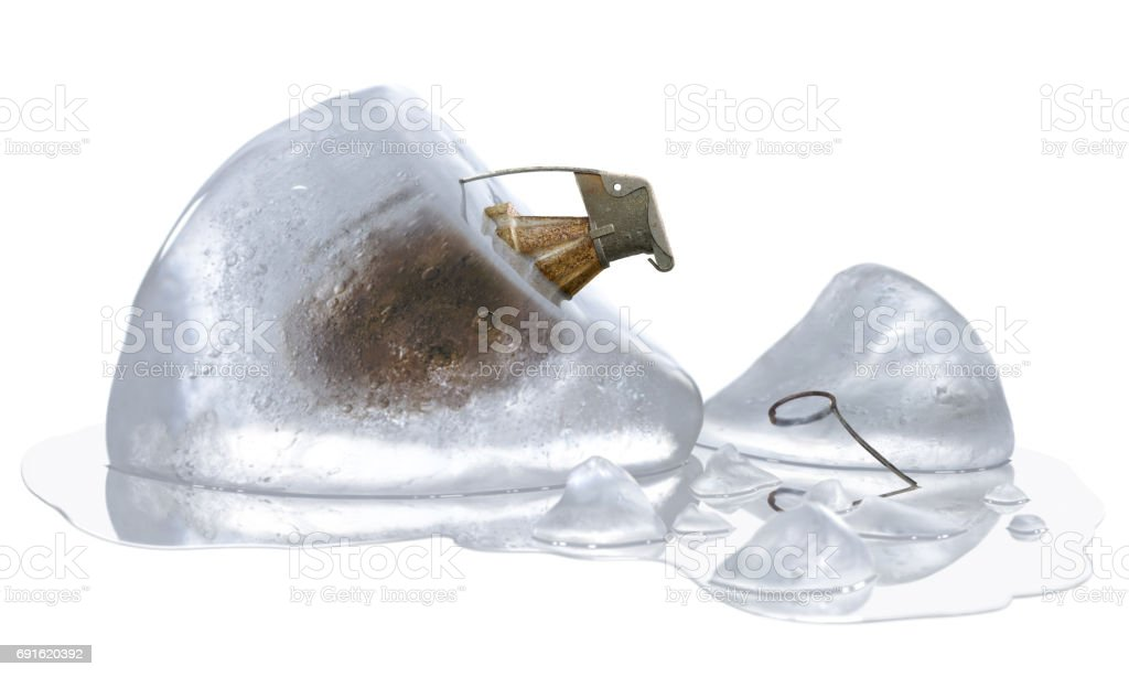 Time bomb represented by unpinned grenade in melting ice, isolated on white background stock photo