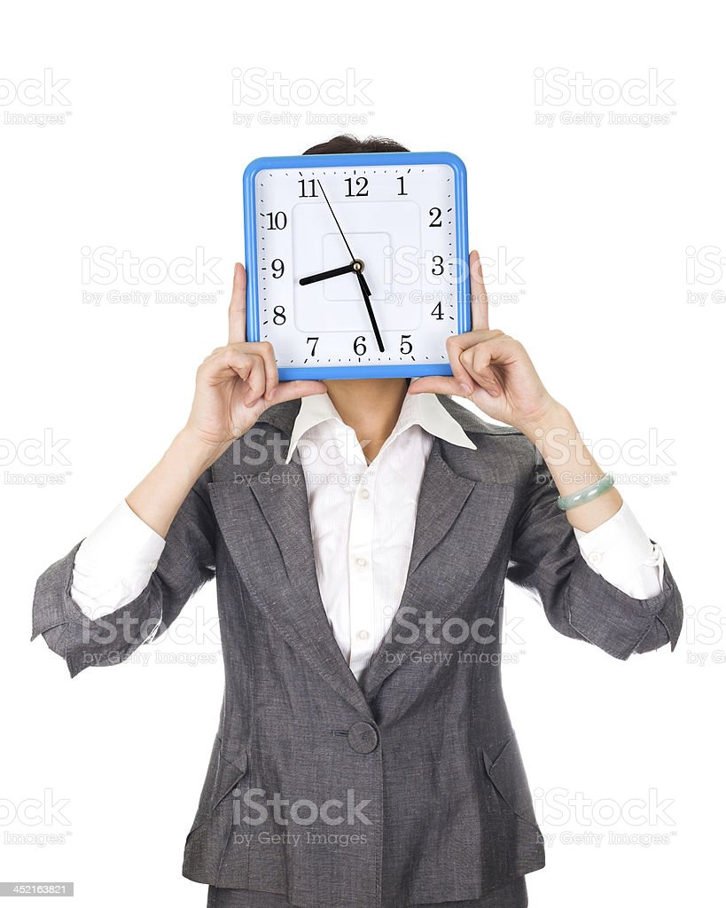 Time concept:Asian woman holding clock isolated on white background stock photo