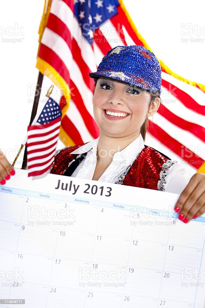 Time: Female wearing Indepence Day clothing holds July 2013 Calendar royalty-free stock photo