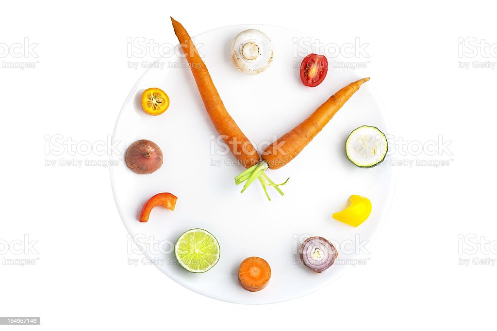 Time for food - clock made from assorted fruit & vegetables stock photo