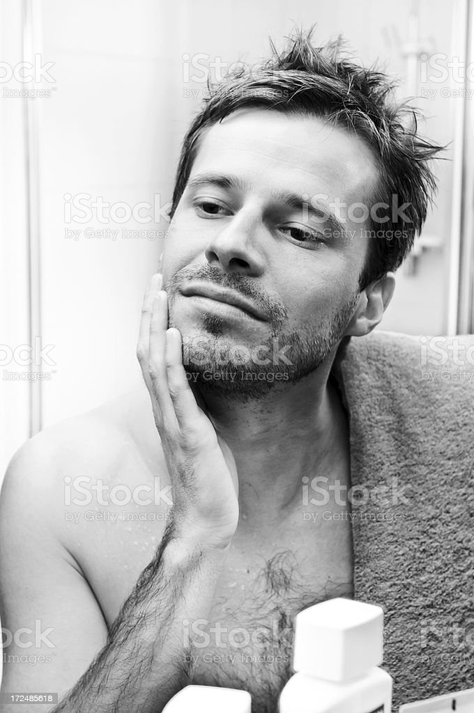 Time for shaving! Young man is going to cut beard royalty-free stock photo