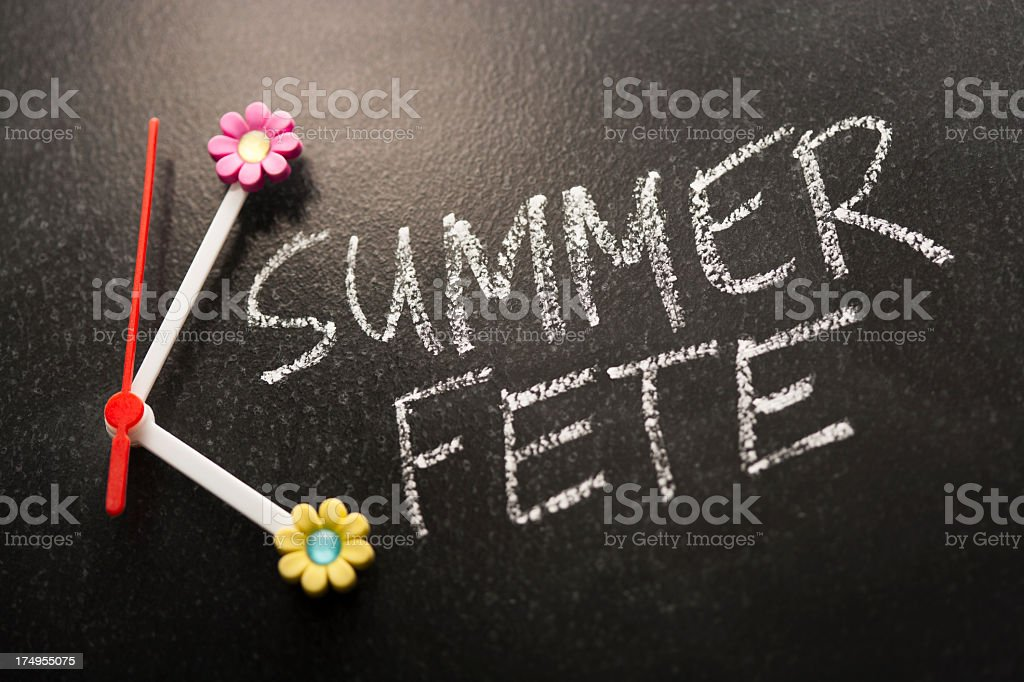 Time for the Summer Fete handwritten on chalkboard royalty-free stock photo