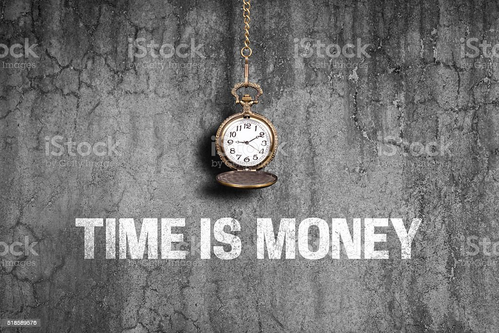 Time is money concept on old wall stock photo