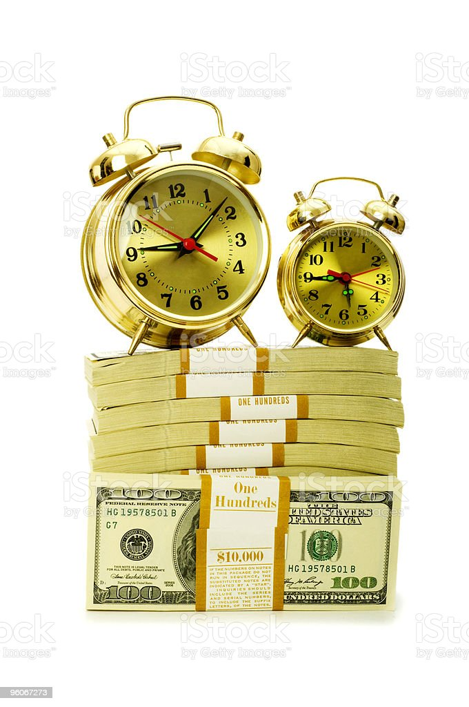 Time is money concept with dollars and clock royalty-free stock photo
