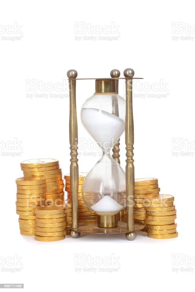 time is money concept with hourglass stock photo