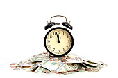 Time is money concept with old clock and bills