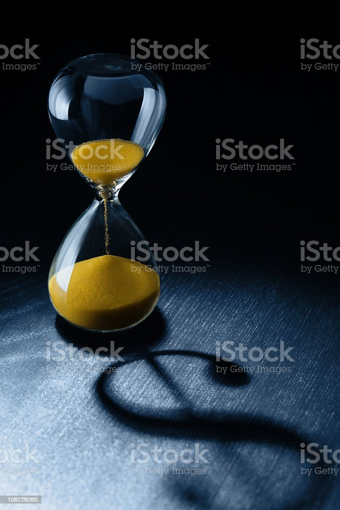 Time is Money, Hourglass with Dollar Sign Shadow stock photo