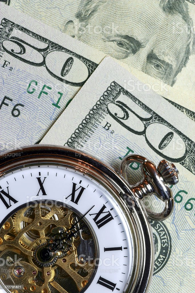 50/50 - Time is Money royalty-free stock photo