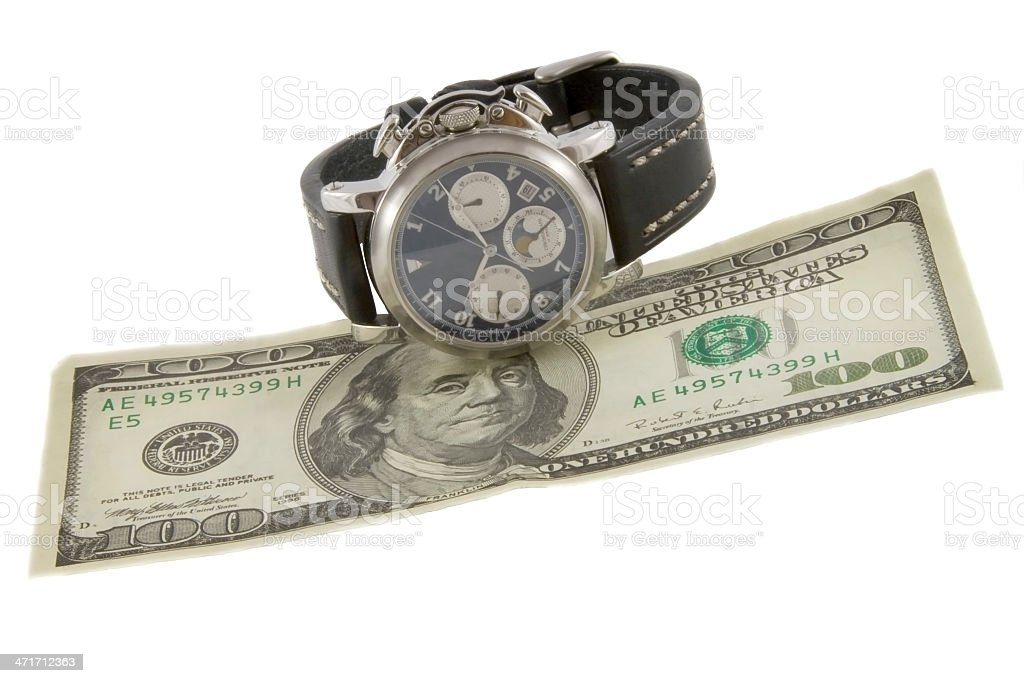 Time is money. Watch and hundred dollars banknote royalty-free stock photo