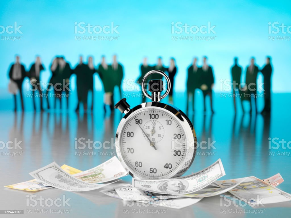 Time is Money with a team of Business People royalty-free stock photo