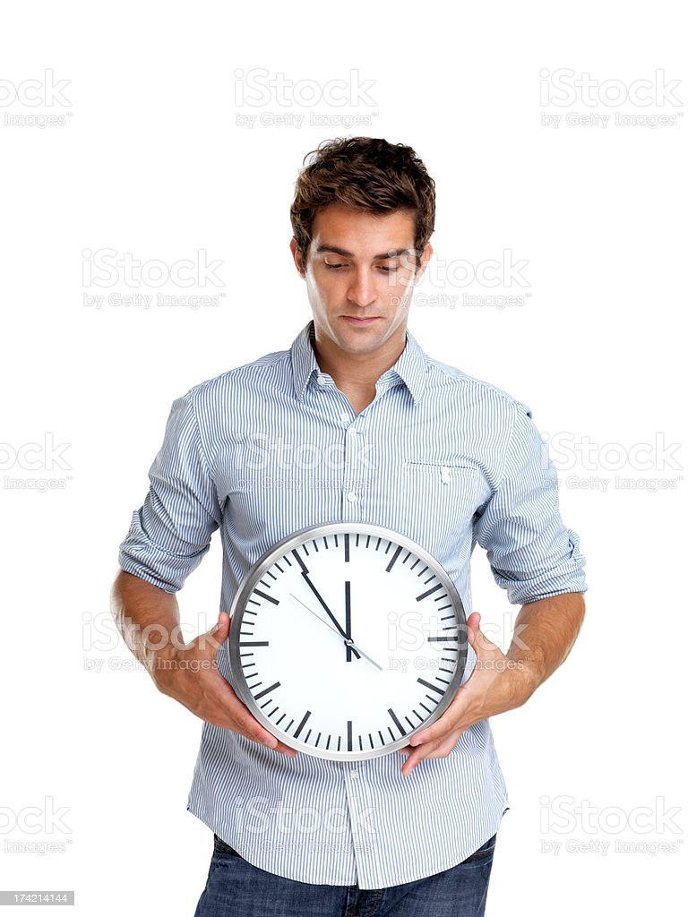 Time is money - Young man holding a clock in hand stock photo