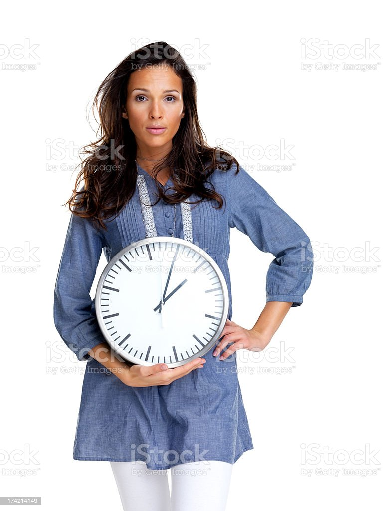 Time is money - Young woman standing with a clock stock photo