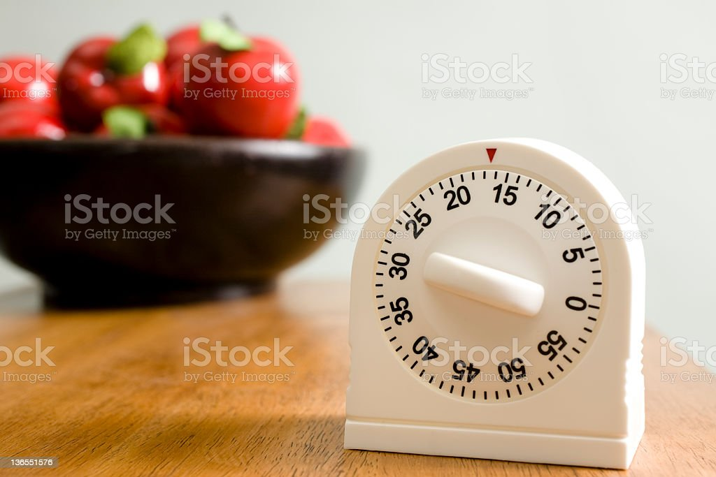 Time.  Kitchen timer on counter stock photo