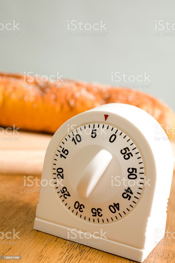 Time.  Kitchen timer on counter royalty-free stock photo