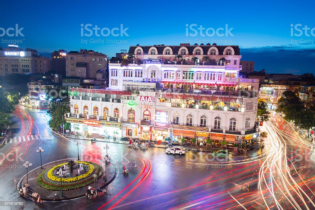 Time lapse photo of city building and roundabout at night stock photo