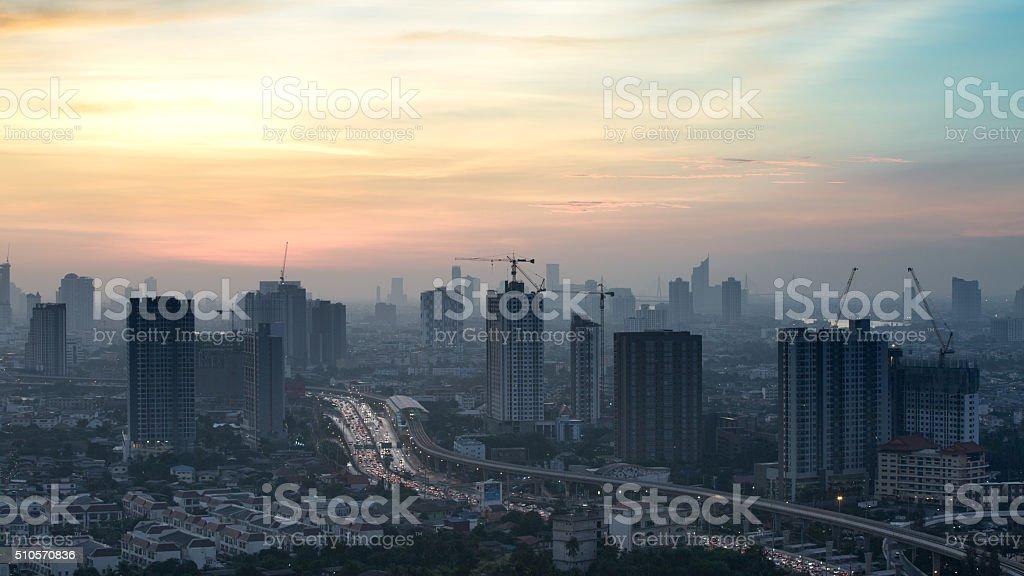 Time lapse view of Bangkok skyline at sunrise. stock photo