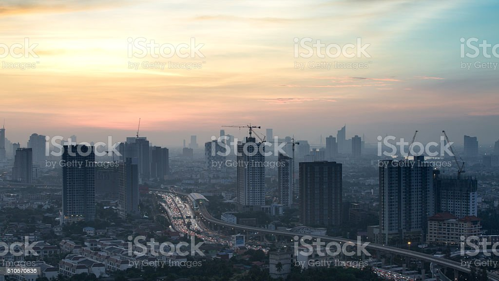 Time lapse view of Bangkok skyline at sunrise. stock photo