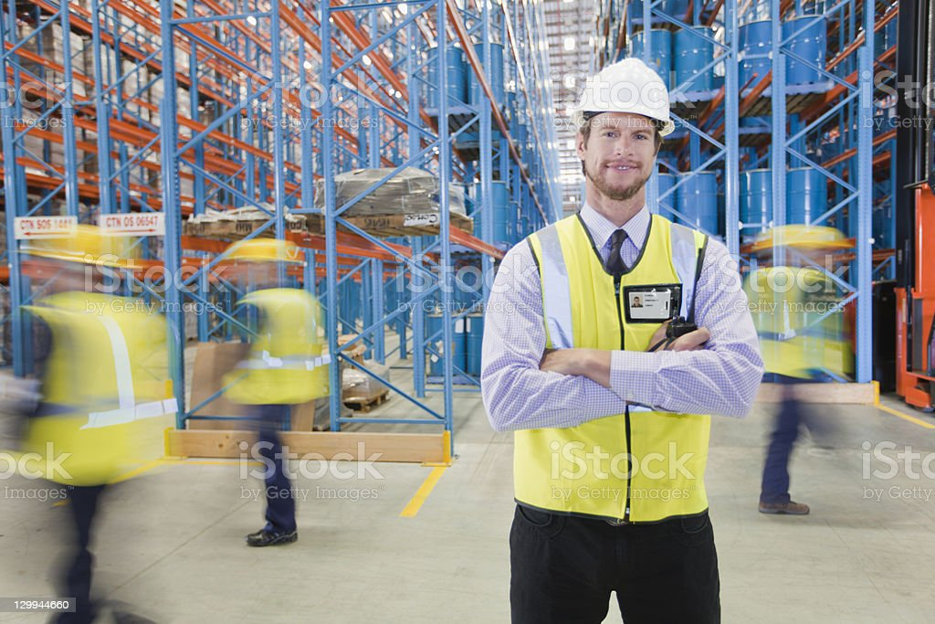 Time lapse view of workers in warehouse stock photo