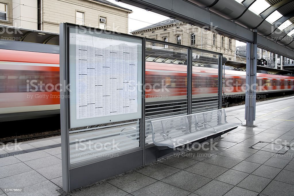 Time table, waiting seat and train stock photo