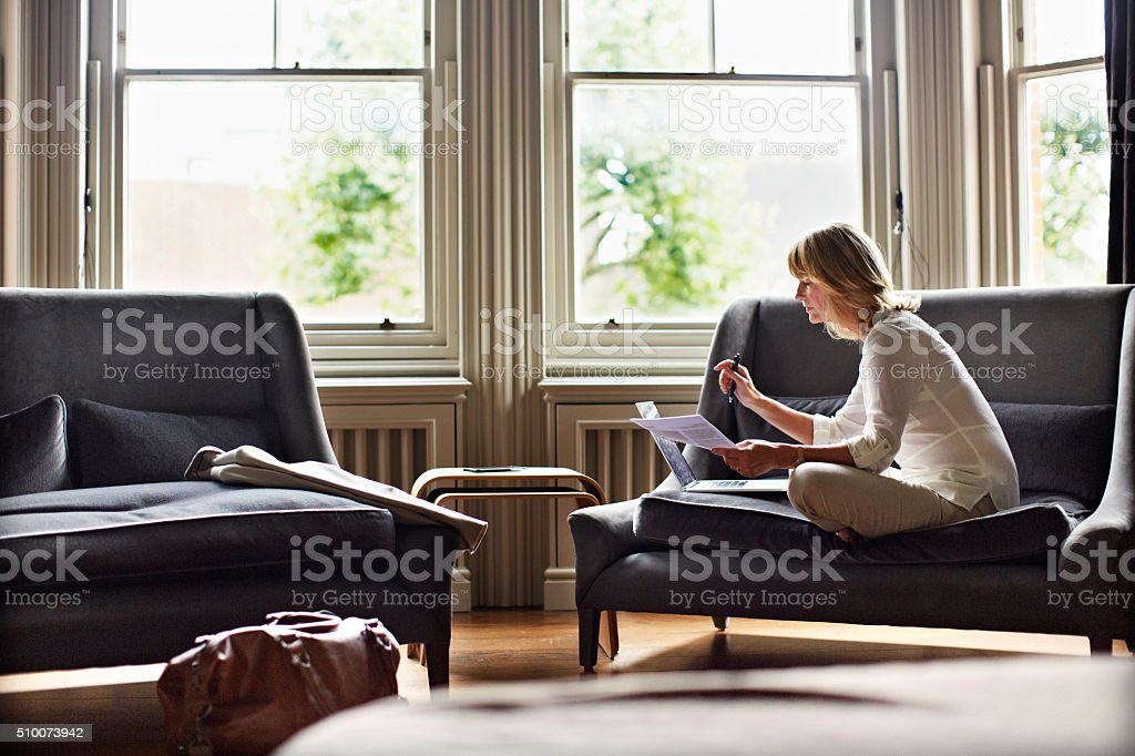 Time to catch up on her emails stock photo